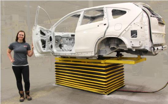 Pneumatic height adjustable platform for an automotive shell